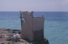 The Bathroom over an open hole to the sea. High tide was problematic